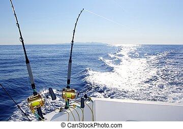 Trolling offshore fisherboat rod reels wake sea reflection...
