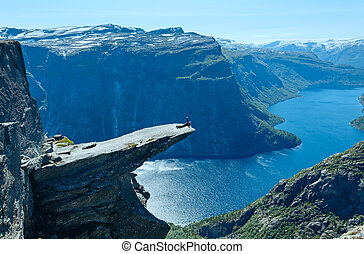 Trolltunga summer view (Norway) and man on rocks edge.