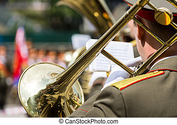 Trombone player in military band