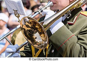 trombone player plays his trombone on parade
