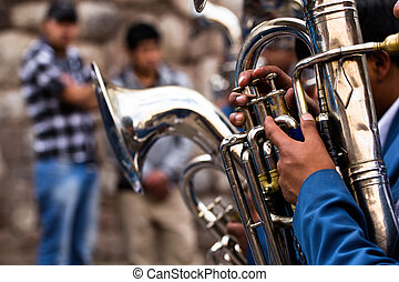 Trombones playing in a big band.