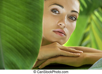 tropic spa - portrait of young beautiful woman on green...