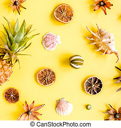 Tropical abstract background, pattern with pineapple on yellow background. Summer concept. Flat lay, top view.