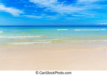 Tropical beach and beautiful sea. Blue sky with clouds in...