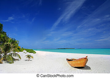 Tropical beach and ship - Tropical Maldivian beach with...