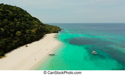 Tropical beach and turquoise lagoon water - Tropical...