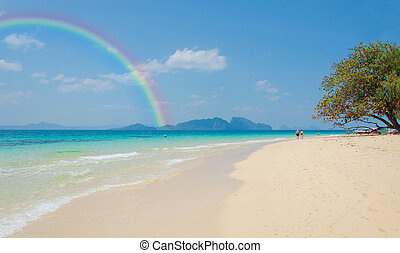 Tropical beach Andaman Sea, Thailand. - Colorful rainbow...