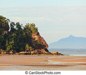 Tropical beach at low tide sunrise