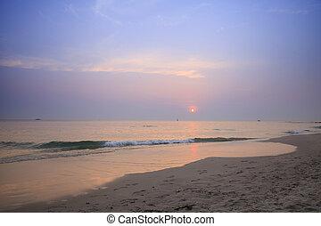 Tropical beach at sunrise in thailand