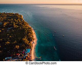 Tropical beach, boats and ocean, aerial view at Gili island