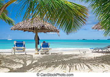 Tropical beach - Chairs on white sand tropical beach