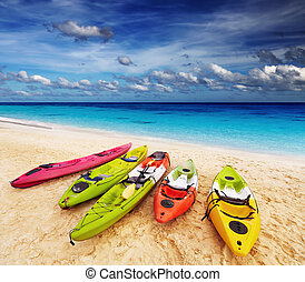 Tropical beach - Colorful kayaks on the tropical beach,...
