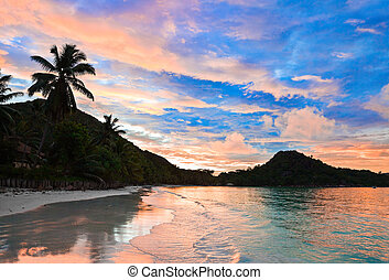 Tropical beach Cote d'Or at sunset, Seychelles - vacation background