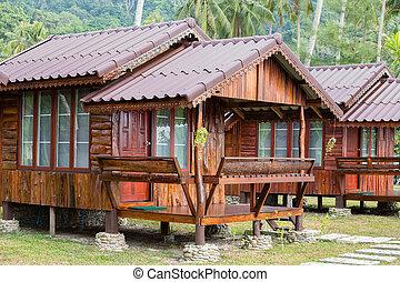 Tropical beach house near sea, close up - Tropical wooden...