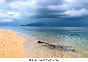 tropical beach in a rainy weather