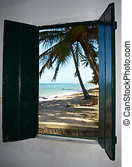 Tropical beach in Brazil seen through a window church