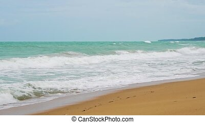 tropical beach on the island, waves are slowly breaking about the sand, tourism and travel