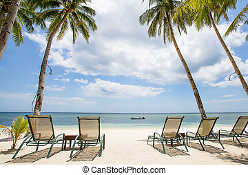 Tropical beach, perfect place for relaxing, sun recliner in...