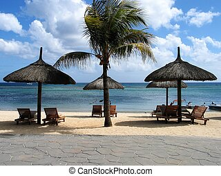Tropical beach - Symetrical huts on tropical beach