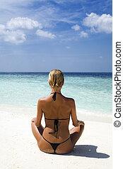 tropical beach: perfect girl meditating on a tropical beach....