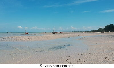 Tropical Beach Sands with Grounded Boats