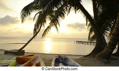 Tropical Beach Scene Water Sports - Water sports kayaking...