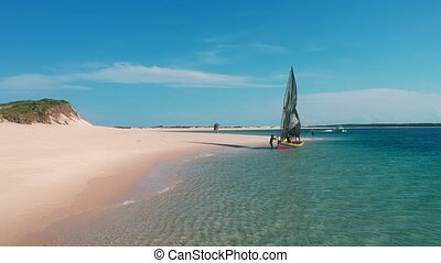 Tropical Beach Scene with Sailbout and People