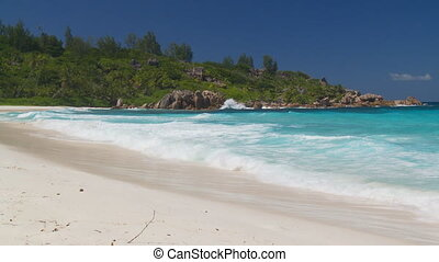 tropical beach scenery - waves rolling in on fantastic beach