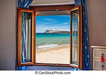 beach seen through an open window