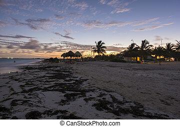 Tropical beach sunset - Tropical Caribbean public beach on...