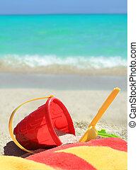 Tropical beach toys and ocean