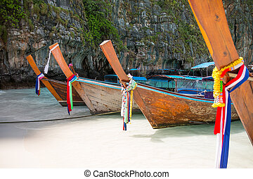 Tropical beach, traditional long tail boats, famous Maya Bay