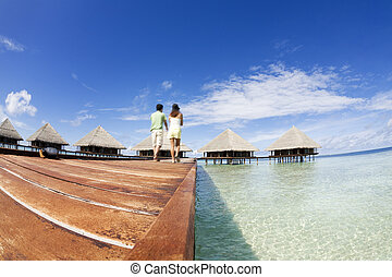 tropical beach: tropical resort and cloudy sky