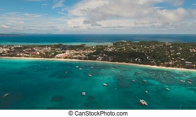 Tropical beach with and turquoise sea - Aerial footage sand...