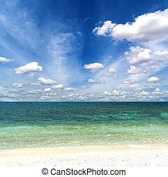 Tropical beach with blue sky