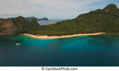 Tropical beach with boats, aerial view. Tropical island.