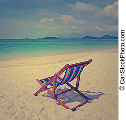 Tropical beach with colorful beach chair