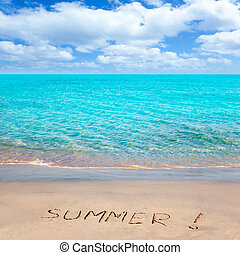Tropical beach with Summer word written in sand