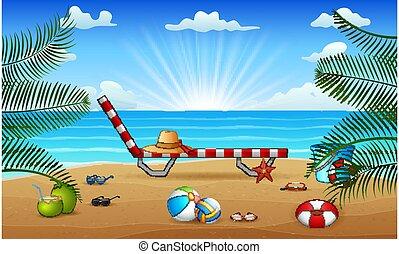 Tropical beach with toys on the sea sand