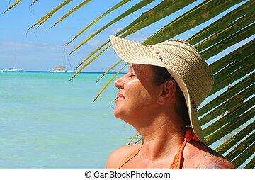tropical beach woman - voluptuous woman soaks up the sun...