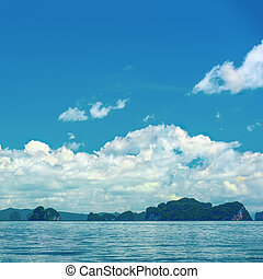tropical blue ocean and clouds on sky with island, travel destination, Thailand