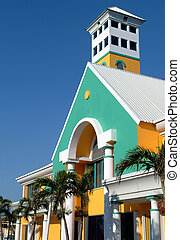 Tropical building - yellow and turquoise building in the...