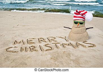tropical Christmas snowman on beach