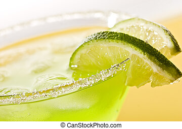 tropical cocktail - Macro view of cold lime cocktail with...