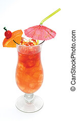 Tropical drink in a hurricane glass with orange slice, cherry and a paper umbrella