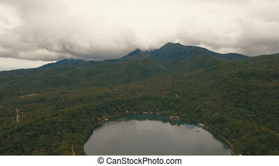 Tropical forest in the mountains with lake. Camiguin island Philippines.