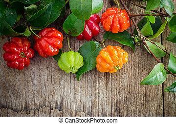 Tropical fruit also called Pitanga, Brazilian Cherry,...