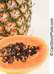 Tropical Fruit - Half of a papaya & a pineapple behind it.