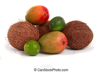 Tropical Fruit - Mangos, limes and coconuts on a white...