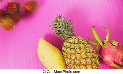 tropical fruit on a bright pink background. Minimal fruit concept.